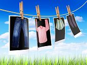 stock photo of clothes hanger  - Pictures of clothes hanging on a cord outdoors to get dry - JPG
