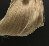 picture of hair streaks  - Blond hair isolated on black - JPG