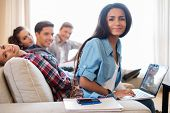 image of exams  - Group of multi ethnic young students preparing for exams in home interior - JPG