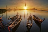 foto of sea-scape  - andaman long tailed boat southern of thailand floating on clear sea water with sun shine in phuket - JPG