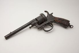 stock photo of revolver  - old style colt revolver rusted and damaged - JPG