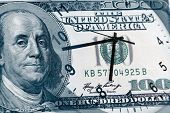 pic of american money  - Clock and American banknote - JPG