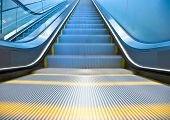 picture of escalator  - Bottom of an empty escalator in an office building - JPG