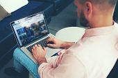 image of internet-cafe  - Business man using notebook in cafe or office hall make money online e - JPG