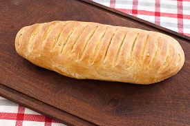 pic of home-made bread  - home made bread on wooden board  - JPG