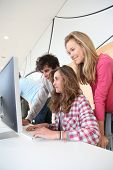 Students in training course looking at desktop computer
