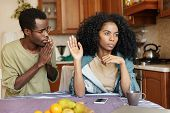 Young African Male Begging His Girlfriend To Forgive Him. Husband Asking His Pretty Wife For Forgive poster