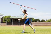 Постер, плакат: Female athlete throwing a javelin