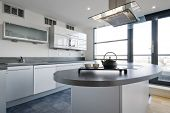 luxury kitchen with separate work areas and modern appliances