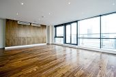 unfurnished penthouse living room with floor to ceiling windows