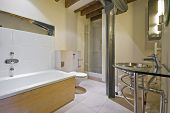 luxury bathroom with contemporary elements in warehouse conversion