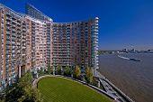 modern residential building on river thames, london