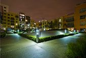 modern development with communal garden after dark