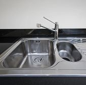 modern stainless steel kitchen sink detail shot
