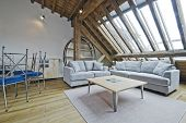 loft apartment of a warehouse conversion with exposed beams