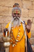picture of jainism  - jain priest welcoming saluting in jaisalmer in rajasthan state in india - JPG