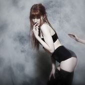 image of spanking  - studio shot of a beautiful cute babe with underwear on isolated background - JPG