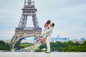 Romantic Loving Couple Having A Date Near The Eiffel Tower poster