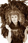 Beautiful Bohemian Woman In Leopard And Feather Native Mask And Hat With Gems And Strong Teal Eyes
