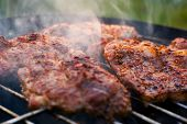 stock photo of flank steak  - Delicious chuck steaks on the grill - JPG