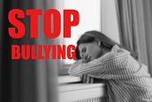 Message Stop Bullying And Sad Woman Sitting Near Window Indoors, Black-white Effect poster