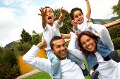picture of family fun  - family having fun outdoors looking very happy
