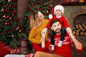 Young Happy Family: Mother Female Woman, Father Male Man And Child Kid Boy In Red Santa Hats And War poster
