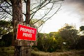 Red Sign With White Lettering On A Tree In Vintage Old Wood On The Red Sign With Private Property Si poster