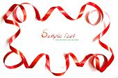 Shiny red ribbon frame on white background with copy space.