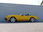 Bright yellow Triumph Spitfire