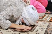 stock photo of praying  - Muslim girls praying at mosque - JPG