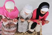 Muslim girls praying at mosque indoor