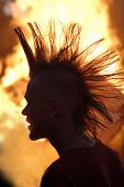 picture of iroquois  - A young man with Iroquois hairdo standing in front of a midsummer pyre in Denmark
