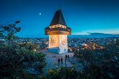 Beautiful Twilight View Of Famous Grazer Uhrturm (clock Tower) Illuminated During Blue Hour At Dusk, poster