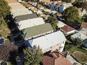 Aerial View Residential Area With Row Of Townhomes And Bright Fall Foliage Color poster