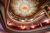 19th Cahors classical theater in France with paintings on ceiling and balcony