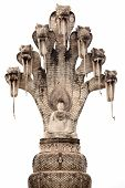 buddha sculpture and seven headed cobra isolated on white, wat khaek, nong khai, thailand