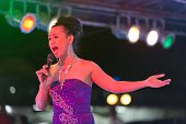 transsexual ladyboy singer performing show on stage, Thailand