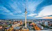 Aerial View Of Berlin Skyline With Famous Tv Tower At Alexanderplatz And Dramatic Cloudscape In Twil poster