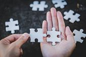 Pieces Of Jigsaw On Palm,pieces Of Jigsaw Puzzle In Women Hands, Business Solutions, Success And Str poster