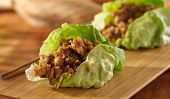 stock photo of thai cuisine  - Asian lettuce wrap with minced chicken and seasonings - JPG