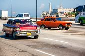 HAVANA-SEPTEMBER 4:Old Chevrolet with the castle of El Morro in the background September 4,2012 in H