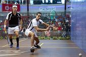 DAMANSARA - SEP 14: Tarek Momen (white) plays Borjan Golan in the men's semi-final of the CIMB Malay