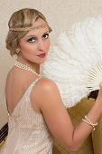 Vintage twenties lady wearing a headband and flapper dress
