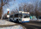 Trolley Bus On A Crossroads