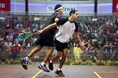 DAMANSARA - SEP 15: Mohamed El Shorbagy (black) shoves Tarek Momen in the men's final of the CIMB Ma