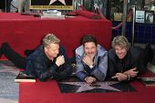 LOS ANGELES - SEP 17: Gary LeVox, Jay DeMarcus, JoeDon Rooney at a ceremony where the band Rascal Fl