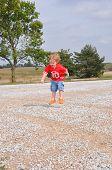 Child Jumping On Gravel