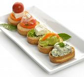 Toasted Bread Slices With Spinach Dip,Avocado,Cheese And Tomatoes