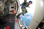 SATTAHEEP, THAILAND - SEPTEMBER 12: Thai navy parachute team jumps out of the airplane for show in S